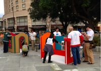 """NetApp volunteers build a playhouse for """"Christmas in the Park"""""""